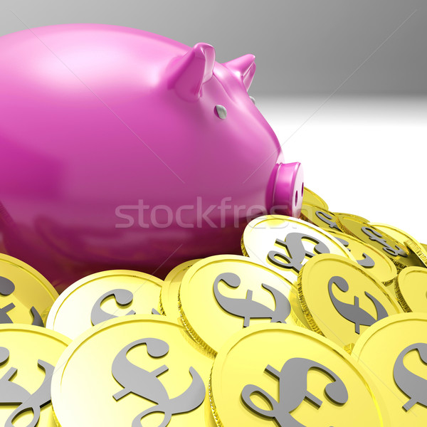 Piggybank Surrounded In Coins Shows Britain Finances Stock photo © stuartmiles