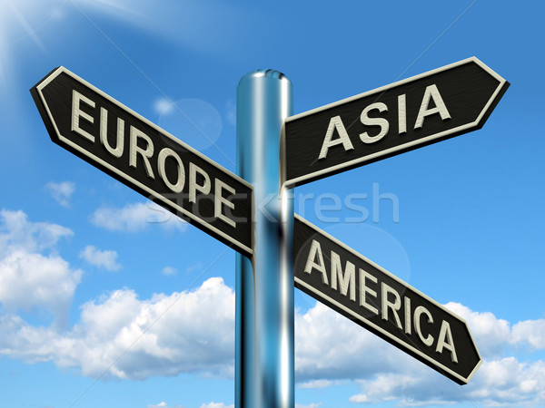Europe Asia America Signpost Showing Continents For Travel Or To Stock photo © stuartmiles