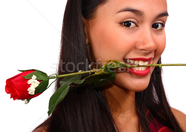 Girl Biting A Rose Given To Her By Her Boyfriend Stock photo © stuartmiles