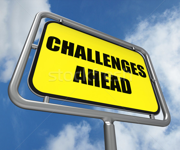 Stock photo: Challenges Ahead Sign Shows to Overcome a Challenge or Difficult