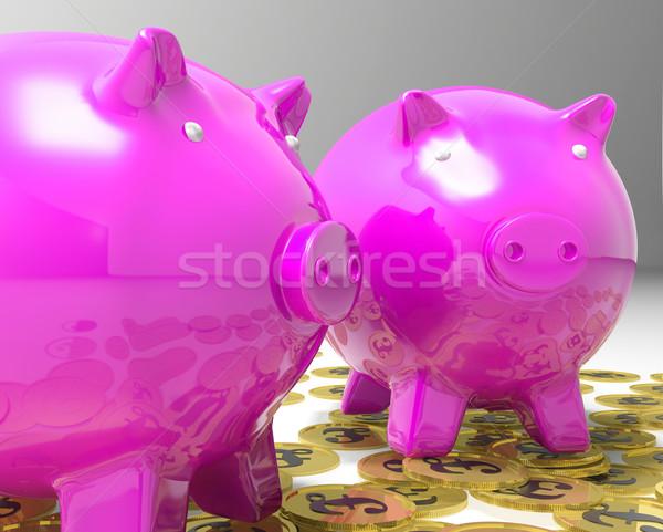Piggybanks On Pound Coins Shows Britain Finances Stock photo © stuartmiles