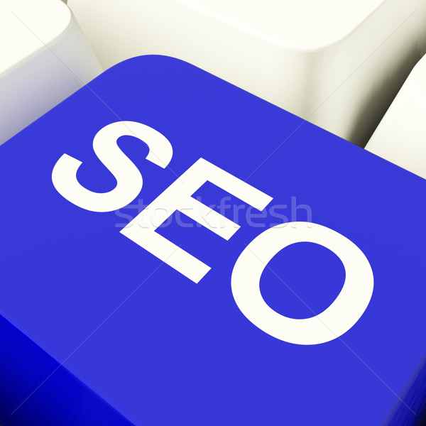 SEO Computer Key In Blue Showing Internet Marketing And Optimiza Stock photo © stuartmiles