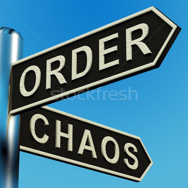 Um Chaos Richtungen Wegweiser Metall Zeichen Stock foto © stuartmiles