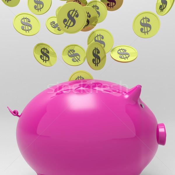 Coins Entering Piggybank Shows Money Saving Stock photo © stuartmiles
