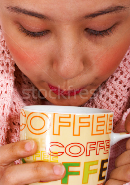 Keeping Snug And Warm With A Cup Of Coffee Stock photo © stuartmiles