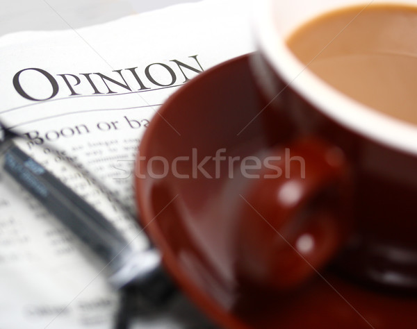 Regarder opinion journal tasse café Photo stock © stuartmiles