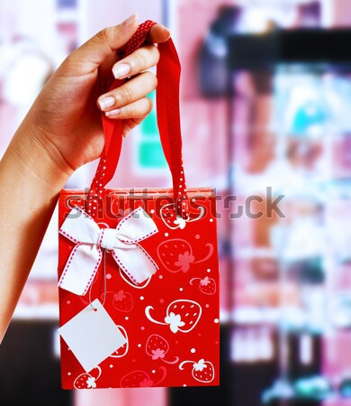 A Gift Wrapped Bag Being Held Up Stock photo © stuartmiles