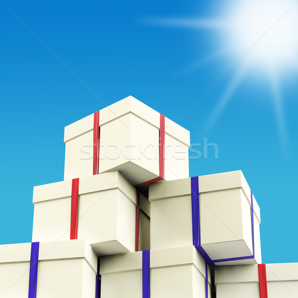 Stack Of Giftboxes With Sun And Sky Background As Presents For T Stock photo © stuartmiles