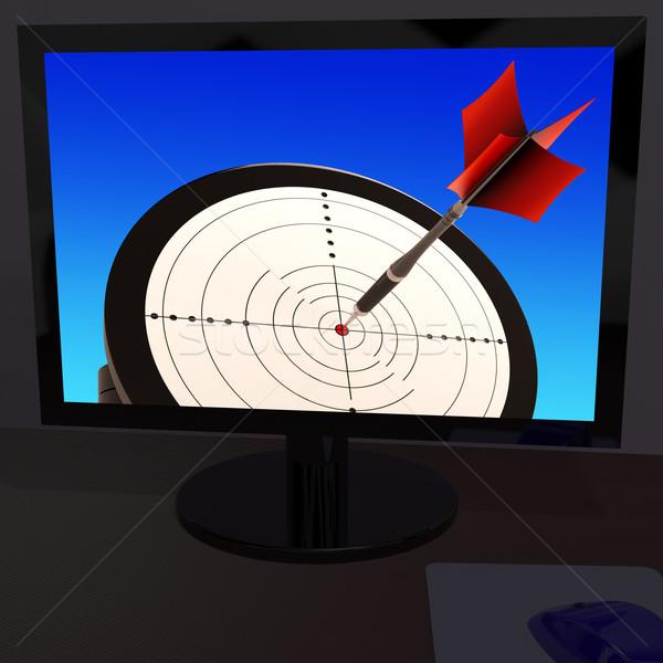 Arrow Aiming On Monitor Showing Performance Stock photo © stuartmiles