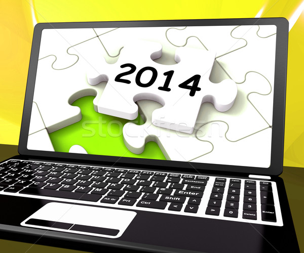 Two Thousand And Fourteen On Laptop Shows New Years Resolution 2 Stock photo © stuartmiles