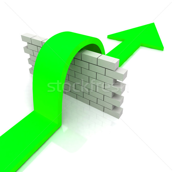 Green Arrow Over Wall Means Overcome Obstacles Stock photo © stuartmiles