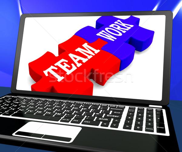 Team Work On Laptop Shows Unity Stock photo © stuartmiles