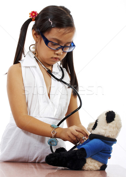 Girl Playing At Being A Doctor Stock photo © stuartmiles