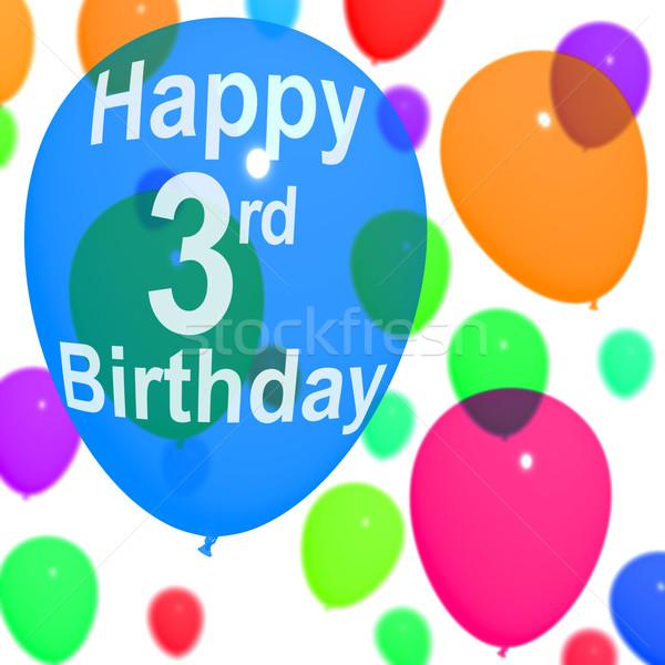 Veelkleurig ballonnen vieren derde verjaardag Blauw Stockfoto © stuartmiles