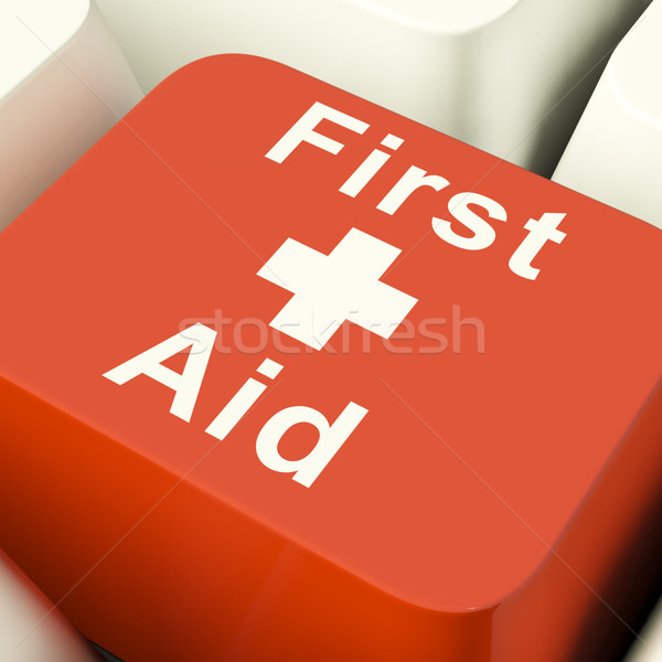 First Aid Computer Key Showing Emergency Medical Help Stock photo © stuartmiles