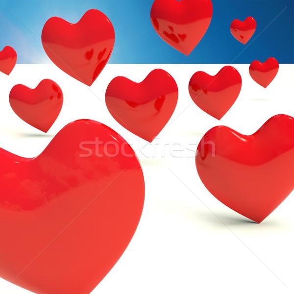 Falling Hearts Representing Love And Romance Stock photo © stuartmiles