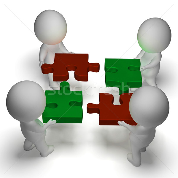 Jigsaw Pieces Being Joined Shows Teamwork And Assembling Stock photo © stuartmiles