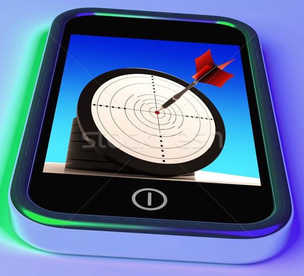 Dartboard On Smartphone Shows Effective Shooting Stock photo © stuartmiles