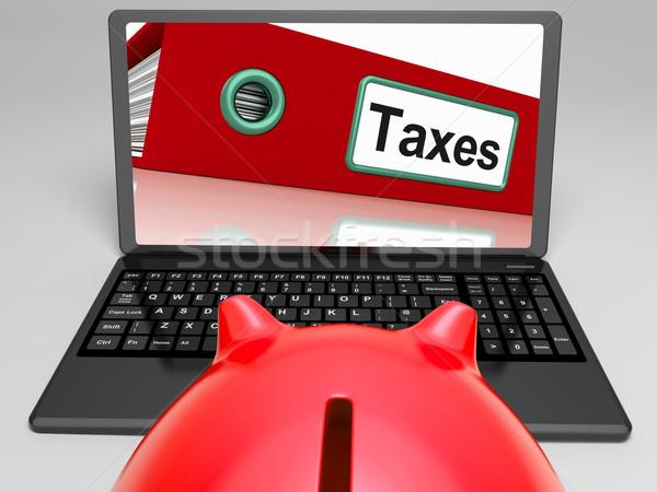 Taxes File On Laptop Shows Taxation Stock photo © stuartmiles