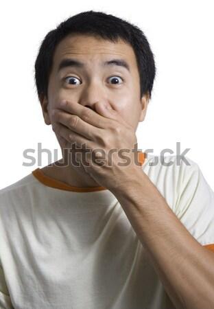 удивленный парень рук лице Сток-фото © stuartmiles