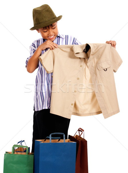 Boy Looking At Bought Clothes Stock photo © stuartmiles