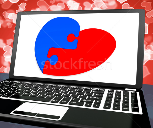 Puzzle Heart On Laptop Shows Engagement Stock photo © stuartmiles