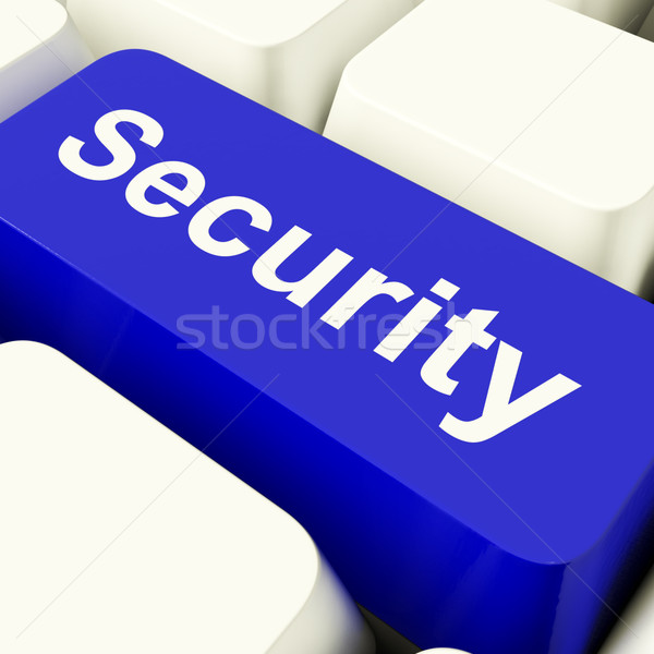 Stock photo: Security Computer Key In Blue Showing Privacy And Safety