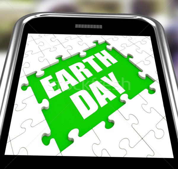 Jour de la terre smartphone conservation environnement protection Photo stock © stuartmiles