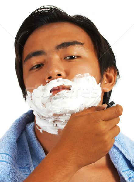 Jeune homme miroir visage homme jeunes soins Photo stock © stuartmiles