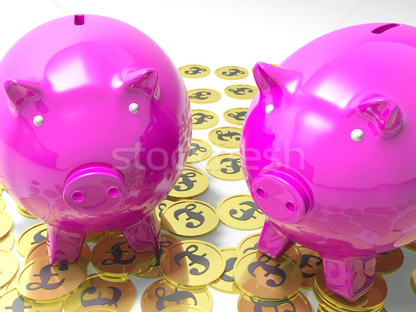 Piggybanks On Pound Coins Shows Wealthy Savings Stock photo © stuartmiles