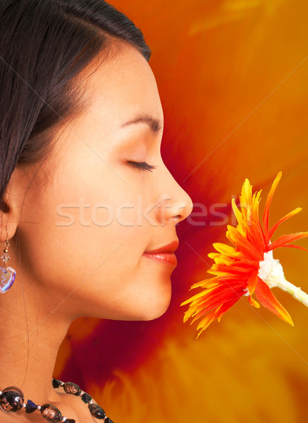 Relaxed Girl Smelling A Flower Stock photo © stuartmiles