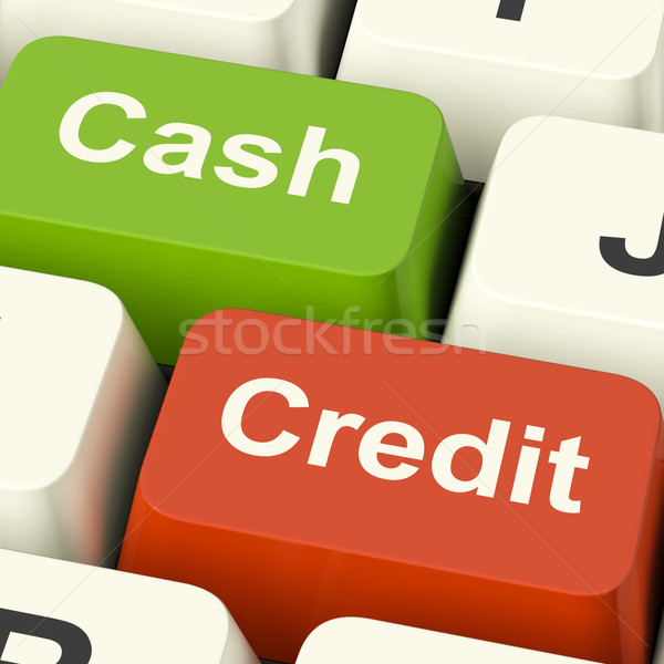 Cash And Credit Keys Showing Consumer Purchases Using Money Or D Stock photo © stuartmiles