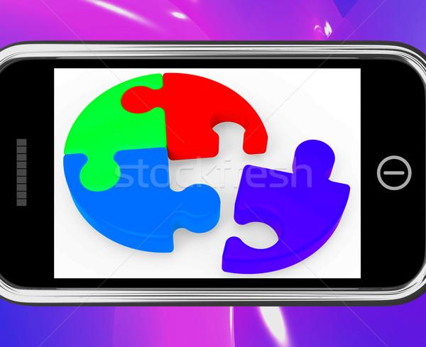 Unfinished Puzzle On Smartphone Showing Teamwork Stock photo © stuartmiles