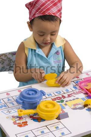 Child playing with plastic kitchen utensils Stock photo © stuartmiles
