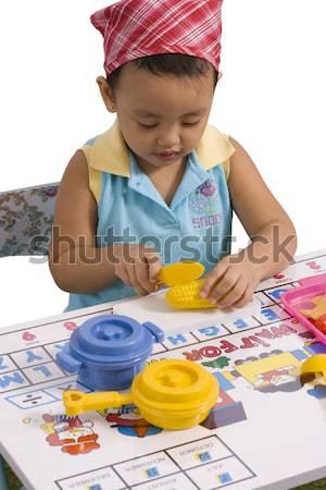 Gyermek játszik műanyag konyha kellékek szórakozás Stock fotó © stuartmiles