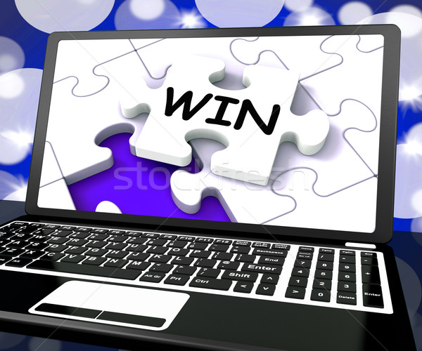 Win Puzzle On Laptop Shows Victory Stock photo © stuartmiles