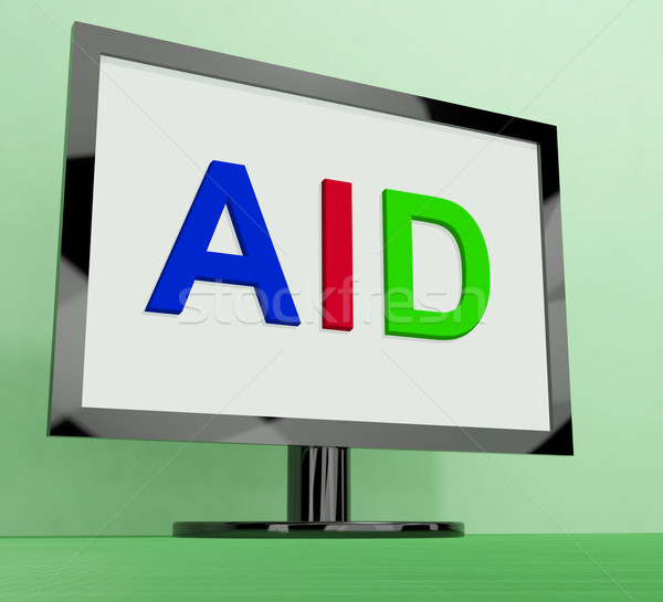 Aid On Monitor Shows Aiding Help Or Relief Stock photo © stuartmiles