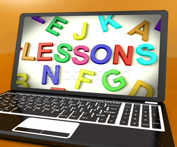 Lessons Message On Computer Screen Showing Online Education Stock photo © stuartmiles