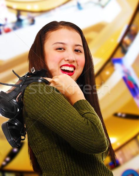 Mosolyog tinédzser vásárlás központ tart cipők Stock fotó © stuartmiles