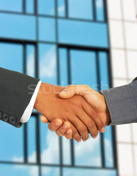 Businessmen Greet Each Other By Shaking Hands Stock photo © stuartmiles