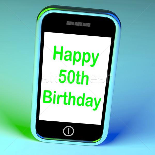 Boldog ötvenedik születésnap okostelefon ötven jelentés Stock fotó © stuartmiles