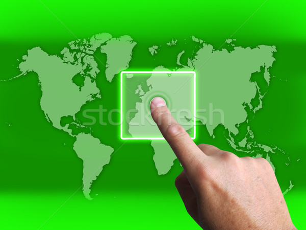 Hand Touch Touchscreen On World Map Shows Internet WWW Stock photo © stuartmiles