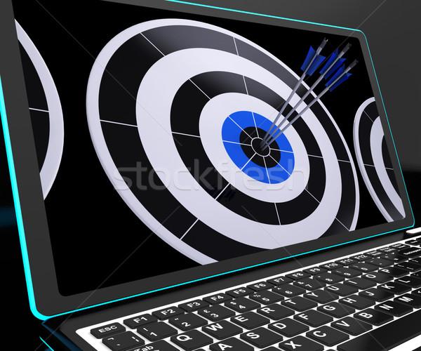 Arrows On Laptop Shows Perfection Stock photo © stuartmiles