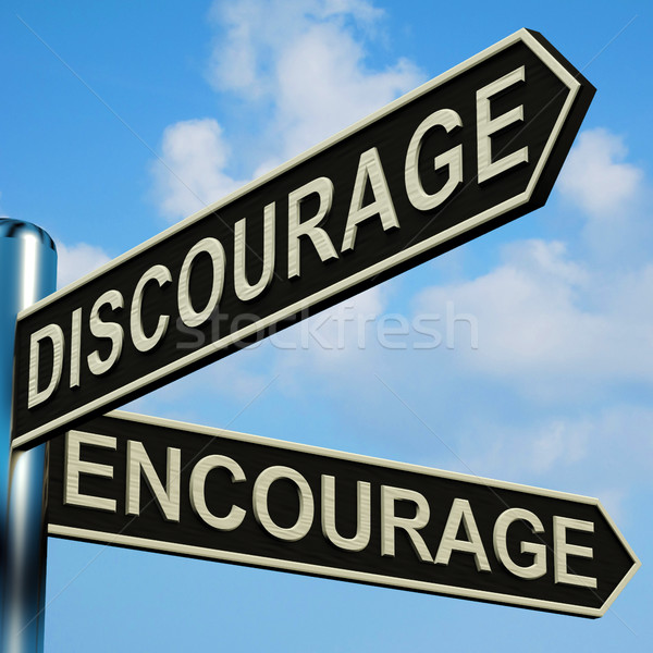Discourage Or Encourage Directions On A Signpost Stock photo © stuartmiles