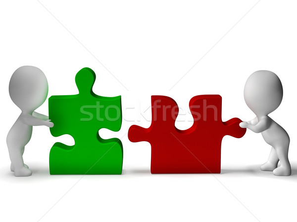 Jigsaw Pieces Being Joined Shows Teamwork And Collaboration Stock photo © stuartmiles