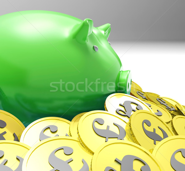 Piggybank Surrounded In Coins Shows European Incomes Stock photo © stuartmiles