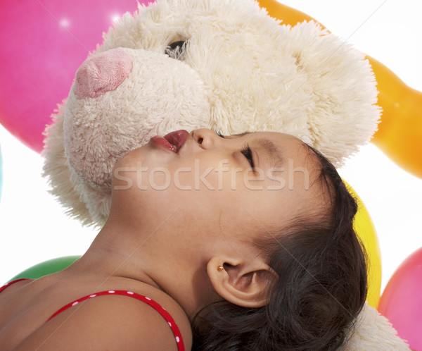 Little Toddler Playing With Her Teddy Bear Stock photo © stuartmiles