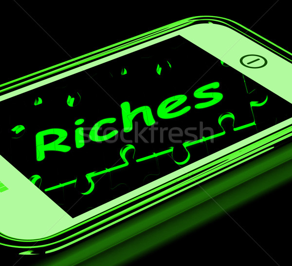 Riches On Smartphone Showing Wealth Stock photo © stuartmiles