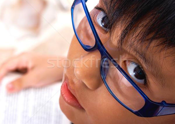 Eszes iskolás gyerek olvas könyv szemüveg arc Stock fotó © stuartmiles