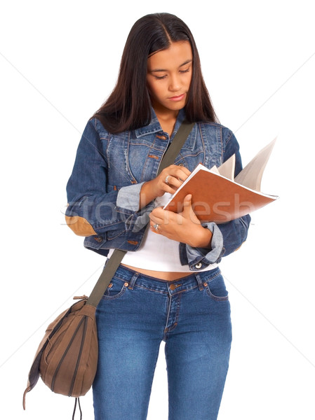 Stock photo: Young Student Reviewing Her Textbook